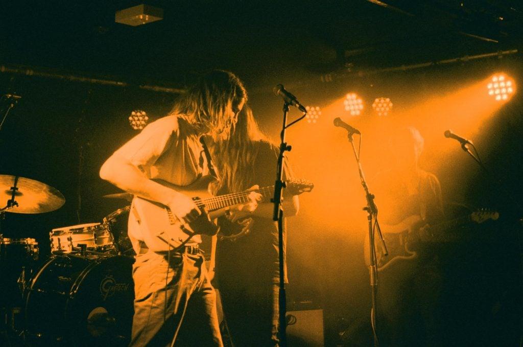Sam Harding live performance playing guitar